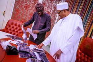 After Buhari Failed To Visit Site Of Lagos Explosion, Governor Sanwo-Olu Takes Photographs Of Tragedy To President In Abuja