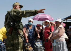 Ukraine: Armed Groups' Arbitrary Pandemic Restrictions
